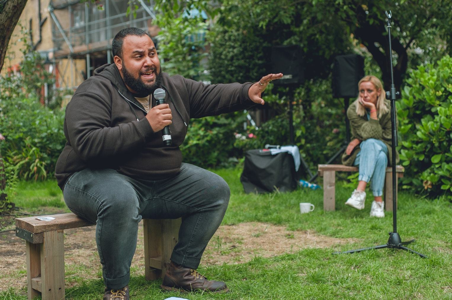 Jordan Castle and Rebecca McKinnis performing in St Anne Comes Home in the grounds of The Actors' Church